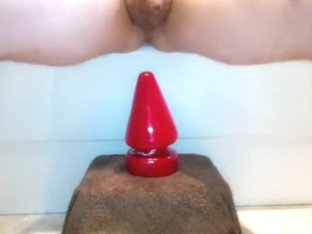 Anal stretching with a bottle, massive plugs and fisting