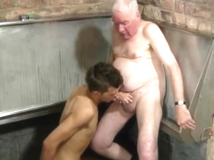 Good looking grandpa young man suck each other in a public