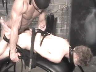 Young slave serving master in dungeon
