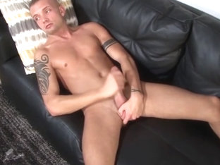 Tattooed military hunk POV tugging in closeup