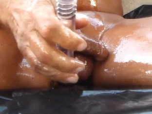 Oiled cock with anal penetration