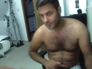 Nice-looking gay is masturbating in the guest room and memorializing himself on web camera