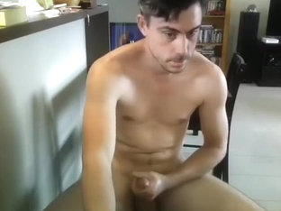 Seductive man is masturbating in a small room and memorializing himself on computer webcam