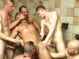 Muscle stud gangbanged at Club Eros sex club