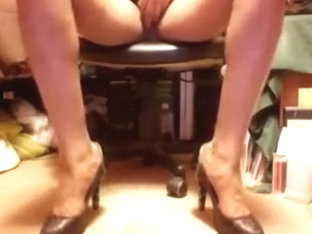 Black and silver high heel pumps and upskirts