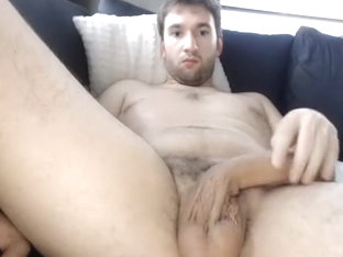 Cute man is jerking off in his room and shooting himself on computer webcam