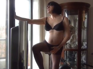 Naughty gigi smoking in black pantyhose and bra