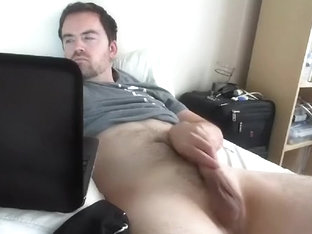 Comely homosexual is having fun in the apartment and memorializing himself on computer webcam