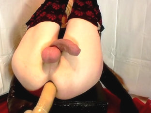 Sissy doll gets a bed table fuck