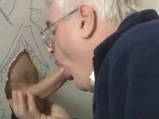 Silver daddy working a big  uncut glory hole cock...