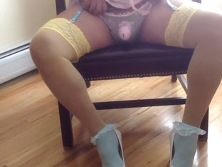 Sissy dolled up in pink chastity