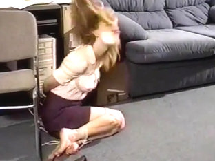 Plucky girl hops then severe hogtie