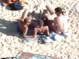 4 Guys Playing On Nude Beach