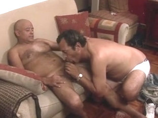 Older Gay Couple Making Sweet Gay Love On The Couch
