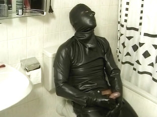 Latex Encased Man Masturbating on Toilet