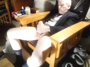 Dad stroking one out in coat and tie