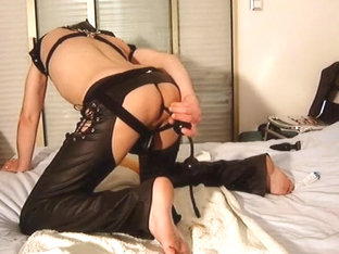 Fetish gay in leather with plug, anal balls and very long dildo