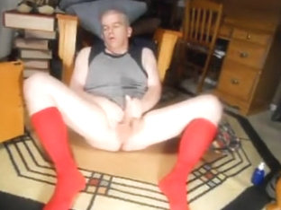 rubbing one out in red OTC socks