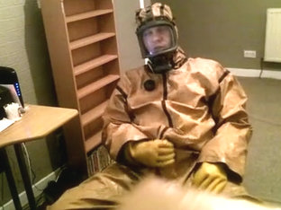 Cumming in a vintage rubber hazmat costume