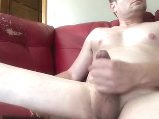 Stroking my big cock and cumming on cam