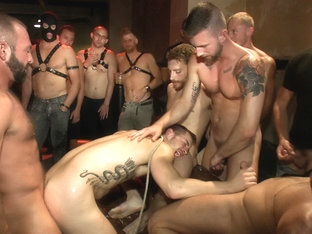 A handsome hunk gets ganged up by 100 horny men during Folsom weekend.