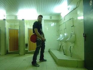Guy stroke in public toilet