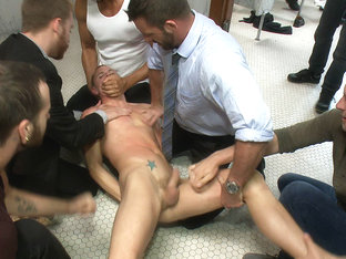 Corporate cunt gets his mouth and ass violated by a mob of horny men.