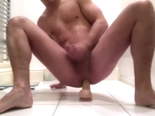 Slut fucks himself with dildo