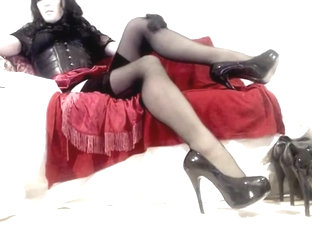 Kinky Crossdresser relaxing in heels and lingerie on cam