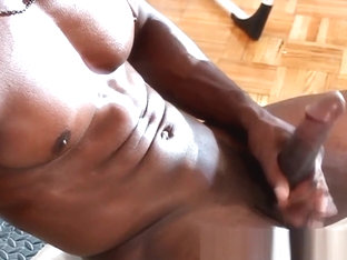 Athletic dark jock working out cock muscles