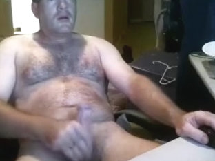 Sexy male is having a good time within doors and filming himself on computer webcam
