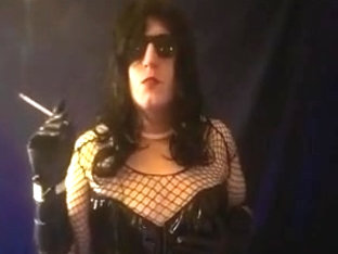 Crossdresser slut smokes vs120 in gloves and pvc