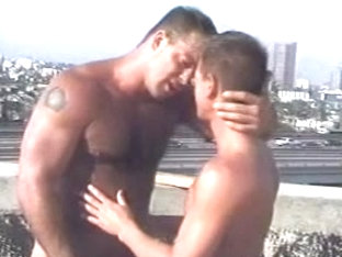 Gay public indecency on a city rooftop
