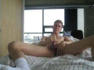 Horny twink in socks jerks off