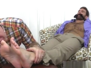 Guy gets his feet tied & licked