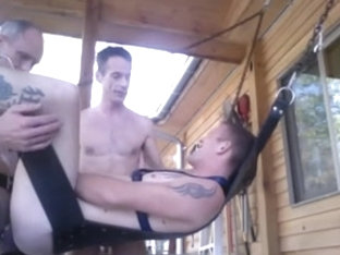 Twink BB by two white top in a sling outdoors