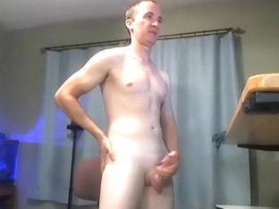 Naughty gay is jerking off in the guest room and shooting himself on computer webcam