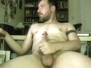 Cute dude is jerking off in a small room and memorializing himself on webcam