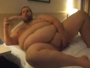 Chubby superchub jerkin-off at a hotel room up to cum discharged