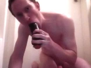 Slut fucks himself with a massive dildo