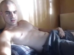 Charming male is having fun in the bedroom and memorializing himself on web cam