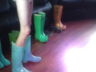 trying on many pairs of wellies wearing a nappy