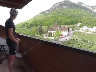 Exhibitionist cums on balcony in biking gear