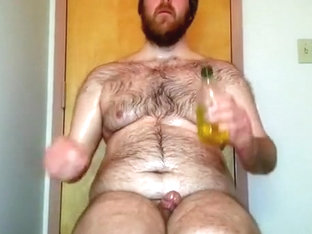 Plugged Bear gets oiled up