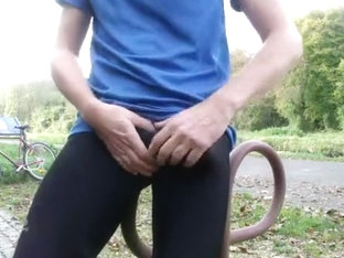 Young pissing and wanking in black lycra in public park
