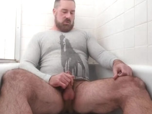 Handsome bear pisses   cums in the tub