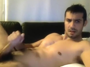 Dishy gay is masturbating in the apartment and memorializing himself on web camera