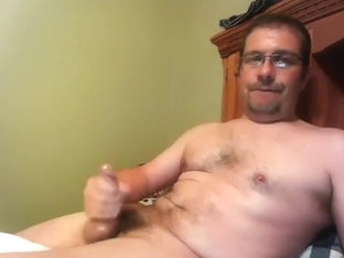 Handsome male is having a good time in the guest room and memorializing himself on computer webcam