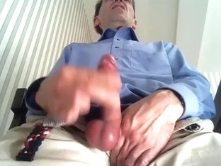 Cute dude is jerking off in the guest room and shooting himself on webcam