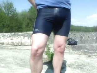 Young cyclist pissing in lycra in the public park